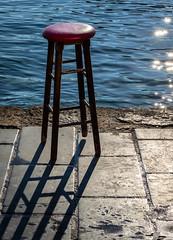 The Walking Bar Stool (Cirrusgazer) Tags: chania crete barstool harbour quayside sea shadows stool sunlight water