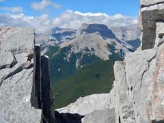 Nihahi Ridge Scramble - Views west as we hide from the wind near the summit (benlarhome) Tags: kananaskis alberta canada nihahiridge trail path hike scramble rockies rockymountain