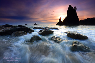 Sunset in the Surf with Split Rock from Rialto Beach in Olympic National Park in Washington