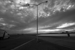 Cross Connect (JasonCameron) Tags: west desert utah rest stop truck black white bw monochrome sunset sundown dusk clouds light post triangle
