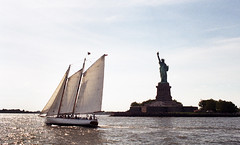 Schooner and Statue of Liberty (neilsonabeel) Tags: nikonfm2 nikon nikkor film analogue newyorkcity statueofliberty boat schooner harbor water