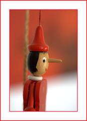 """Tiré par les ficelles . . . SoS """" Made of wood"""" (nickylechatreux) Tags: bois wood rouge smileonsaturday sos madeofwood jouet"""