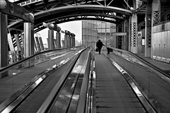 A Journey (susanjanegolding) Tags: airtrain transportation vacation xpro2 blackandwhite monochrome enroute trip traveler movingwalkway movingsidewalk masstransit travel airtraintokennedyairport airtrainjfk jamaicastation trainstation airport