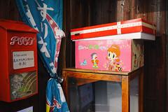 Vintage toys, Showa feeling (Eric Flexyourhead) Tags: kawaramachi 瓦町 takamatsu takamatsushi 高松市 kagawa kagawaken kagawaprefecture 香川県 shikoku 四国 japan 日本 city urban detail fragment shop store toy toys retro vintage pink showa showajidai 昭和時代 mailbox letterbox postbox red sonyalphaa7 zeisssonnartfe35mmf28za zeiss 35mmf28 ひみつのアッコちゃん