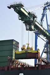 Storage of a container on the cargo liner (ftapressoffice) Tags: ship container port cargo industrial crane freight sea transportation transport harbor liner tanker import export dusk business shipyard global logistics shipping blue city trading water industry town heavy storage waterfront terminal loading freighters boat ocean dock france marseille fossurmer