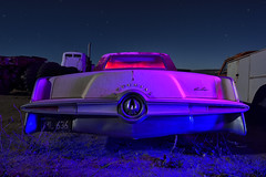 royal purple. 2018. (eyetwist) Tags: eyetwistkevinballuff eyetwist night chrysler imperial decay auto car classic vintage junkyard desert california nikon d7000 nikkor capturenx2 1024mmf3545g 1024mm fullmoon dark longexposure moonlight npy nocturne lightpainting protomachines flashlight wideangle stars startrails faded patina weathered rusty dusty americanwest chrome wheels bumper badge window trunk tailight crown coupe royal purple blue red headliner style crest 1964