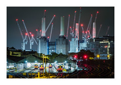 Sleeping Giant (Dave Fieldhouse Photography) Tags: london city citycentre urban night nighttime construction site building constructionsite development crane towercrane chimney train siding lights illumination cityscape tracks railway battersea batterseapowerstation powerstation appartments fuji fujifilm fujixpro2 fujinon 90mm f2