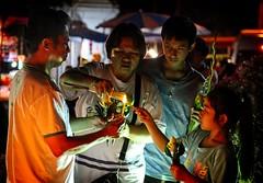 Thai Family Light Incense on Makha Bucha Day at Wat Chedi Luang