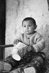 Innocence (Yang Ch'ng) Tags: uigher old town kashgar kashi china xinjiang minorities indigenous silk road black white film vsco photo essay sony 7s travel mood yang chng
