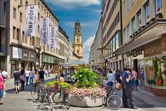 Theatinerstraße, München. (joseph_donnelly) Tags: theatinerstrase marienplatz odeonsplatz munich münchen bayern bavaria people bikes flowers sky shurch spire kirche räder