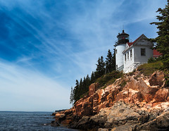 Bass Harbor Lighthouse in Acadia National Park (Modymark) Tags: lighthouse cliff water ocean sea landscape nature sightseeing travel sky tree rocks green blue