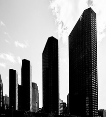 modern monoliths... (Stu Bo) Tags: chicago building towers monolith blackandwhite bw monotone tall light shadows skyward