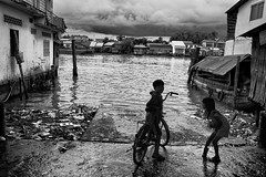 Life on the Mekong Delta (rvjak) Tags: d750 nikon delta vietnam asia asie southeast sudest bicycle kids enfants fille garçon boy girl river rivière houses maisons cloudy nuageux black white noir blanc monochrome bw
