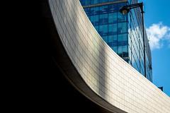 Underpass (Sean Batten) Tags: london england uk europe canarywharf docklands eastlondon city urban lines curves bricks brickwork light shadow sky clue building lamp nikon d800 50mm geometry