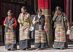 4 Tibetan ladies (bag_lady) Tags: phalkormonastery buddhism monastery 4tibetanladies traditionaldress tibet gyantse nyangchurivervalley 9thcentury bangdian apron