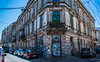 2018 - Romania - Bucharest - Graffiti + (Ted's photos - For Me & You) Tags: 2018 bucharest cropped nikon nikond750 nikonfx romania tedmcgrath tedsphotos vignetting graffiti building streetscene street doors windows vehicles shadow shadows balcony oldbuilding