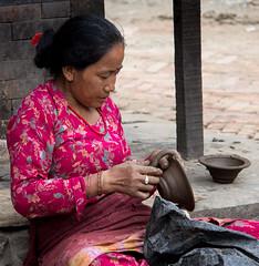 Lady finishing off post (SamKirk9) Tags: nepal kathmandu bhaktapur potterssquare