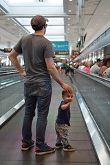 Off to adventure with dad - see ya later, mom (radargeek) Tags: den denver airport travel colorado travelers traveler baby kid kids children waving