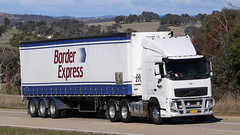 You can always find a BORDER EXPRESS (2/4) (Jungle Jack Movements (ferroequinologist)) Tags: fleet border express sydney melbourne albury table top hume highway jerrawa yass triaxle cadeb anthony tony ryan preanvis kenworth volvo nose cabover white hp horsepower big rig haul haulage freight trucker drive transport carry delivery bulk lorry hgv wagon road semi trailer deliver cargo interstate articulated vehicle load freighter ship move roll motor engine power teamster truck tractor prime mover diesel injected driver cab cabin loud rumble beast wheel exhaust double b grunt