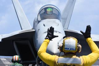 An F/A-18E Super Hornet maneuvers aboard USS Harry S. Truman (CVN 75).