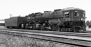 Southern Pacific Baldwin AC-7 Cab Forward articulated 4-8-8-2 steam locomotive # 4156, is seen in a yard area, ca early 1940's