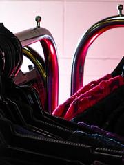 The Clothes Racks (Steve Taylor (Photography)) Tags: clotherack display dress hanger chrome fashion black red pink purple blue gold metal cloth plastic newzealand nz southisland canterbury blouse christchurch shiny