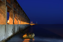 The wall of Decay (panos_adgr) Tags: nikon d7200 drapetsona attica greece port sea water motion sky dusk blue architecture structure geometry pattern rock long exposure night photography