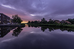 Sundown at river Laak (Dannis van der Heiden) Tags: sundown laak sky river tree farm building house car riet reflection nikond750 d750 amersfoort vathorst netherlands water serene cloud grass foliage sunset dusk markenhaven streetlight quay tokina1628mmf28