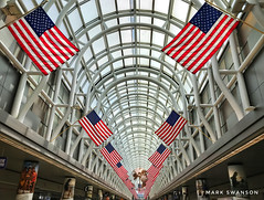 Red, White, and Blue (mswan777) Tags: mobile iphone iphoneography apple beam blue white red illinois usa american o'hare chicago indoor building architecture globe display flag travel airport concourse terminal