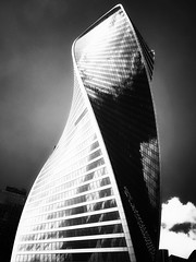 Think whatever ....#Moscow City (NO PHOTOGRAPHER) Tags: hochhaus gebäude cityscape skyline detail construction blackandwhite monochrome architecture architectural urban building outdoor iphoneography iphonephotography exterier russia moscowcity technoart sky clouds moscowphotography blue light shade dark shadow city geometric lookingup window skycraper iphone 6s p aboutlove analogy freestyle fineart blackandwhitephoto monocromephotography bnw bw hochhauspanorama panoramatic 7 москва россия архитектура строительство река мост photography mobile mobilephotography square