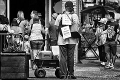 Liquidation Sales (Ian Sane) Tags: ian sane images liquidationsales man cold iced bottled water old town portland oregon blackwhite monochrome candid street photography southwest ankeny 3rd avenue canon eos 5ds r camera ef100400mm f4556l is usm lens