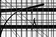 I'm Walking (Leipzig_trifft_Wien) Tags: berlin deutschland de silhouette grid lines diagonal curve lamp composition street human person streetphoto glas bridge architecture black white bnw blackandwhite contrast light shadow