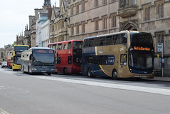 SO 10784 and OBC 354, 862 and 684 @ High Street, Oxford (ianjpoole) Tags: stagecoach oxfordshire alexander dennis enviro 400mmc sn66vzf 10784 the oxford bus company volvo b5lh wright eclipse gemini r4oxf 354 mercedesbenz 0530 citaro cf57oxf 862 streetdeck sk17hho 684 outside university college