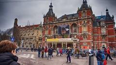 (Travis Daki) Tags: amsterdam tram city downtown people holland outdoors walking by blue grey sky street folks