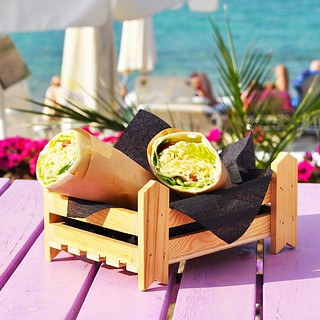 #Tortilla with sauteed chicken, lettuce, tomato and mustard sauce. Served with the best sea view! Enjoy! #CoconesBeachBar #Cocones #Polichrono #Chalkidiki #Cocktail_Bar #Food #Bar_Food #Street_Food #Lounge #Music #Speakeasy #Day_and_Night #Summer_2018 #ne