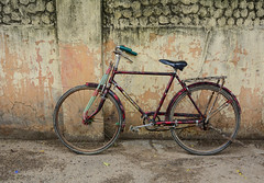 0407-7810 (phuong.sg@gmail.com) Tags: antique asia backgrounds basket bicycle black broken city color concrete cycle damaged day dirty horizontal house image india leaning life mode myanmar nobody object obsolete old orange parking red retro revival scene single stained stationary town transport travel tuscany urban vertical wall wheel yellow