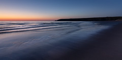 Twilight, Holywell Bay (Mick Blakey) Tags: cscapeart holywellbay mickblakey beach blue cliffs clouds coast coastal contrast cornish cornwall dreamy dusk orange sand sea seascape shadows shoreline silhouette sun sunset surreal tide twilight