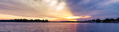 Gold and Violet Sunset Panorama (mikewhalenphotography) Tags: sunet water ocean oceanfront sun clouds sky evening dusk afternoon bay bayou warm warmth landscape florida reflection
