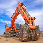 Low Angle Photography of Orange Excavator Under White Clouds - Credit to http://homedust.com/ thumbnail