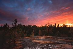 Sunset (AlexanderHorn) Tags: sunset sun clouds cloudporn cloudscape landscape rock trees dramatic finland helsinki visitfinland