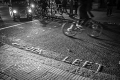 a short story about left-hand traffic (ignacy50.pl) Tags: blackandwhite road street streetphotography sign signage traffic roadtraffic cityscape citylife urban urbex london uk car londoncab bike