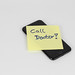 Call doctor on sticky note on cell phone