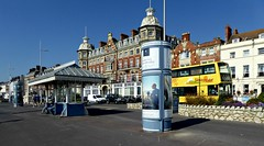 Summer at the Seaside. (jenichesney57) Tags: seaside weymouth build5ngs buses street road blue shelters ornate