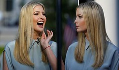 Ivanka Trump howls with laughter at White House as she's interviewed in silky dress