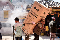 Life's Good . . . A Delivery Man (YogiMik) Tags: delivery man kathmandu nepal lg refrigerator heavy lifting strong carry boudha stupa people smoke incense birds pigeons boy philosophy life greatphotographers