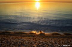 Shining Sea (mswan777) Tags: 1855mm nikkor d5100 nikon stevensville lakemichigan scenic seascape reflection evening coast shore sand beach dune blue orange sun wave water horizon glow sunset