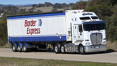 You can always find a BORDER EXPRESS (1/4) (Jungle Jack Movements (ferroequinologist)) Tags: fleet border express sydney melbourne albury table top hume highway jerrawa yass triaxle cadeb anthony tony ryan preanvis kenworth volvo nose cabover white hp horsepower big rig haul haulage freight trucker drive transport carry delivery bulk lorry hgv wagon road semi trailer deliver cargo interstate articulated vehicle load freighter ship move roll motor engine power teamster truck tractor prime mover diesel injected driver cab cabin loud rumble beast wheel exhaust double b grunt