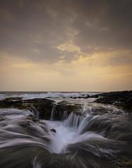 Volcanic Sunset Kona Coast (Tom Yessis) Tags: sunset konasunset clouds color coast canon canonphotography hawaii bigisland beach water wideangle waves waterfall kona kilauea landscape longexposure lava glow