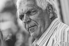 Taking it all in (Frank Fullard) Tags: frankfullard fullard candid street portrait monochrome blackandwhite blanc noir looking gaze stare eyes senior ballina heritage salmon festival mayo irish ireland face expression questioning