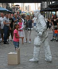 That Magic Moment (dlberek) Tags: child children innocence magic wonder southstreetseaport newyorkcity streetperformer creativity